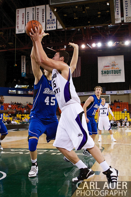 November 27th, 2010:  Anchorage, Alaska - Weber State senior center Trevor Morris (55) makes a move towards the hoop in the Wildcat's 82-81 win over the Drake Bulldogs in the third place game of the Great Alaska Shootout.