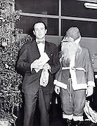 celebrating Christmas at company office USA 1940s