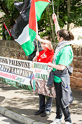 Supporters of the Scottish Palestine Solidarity Campaign demonstrated against Israel's participation in the FIL Rathbones Women's 2015 U19 lacrosse world championships in Edinburgh today. Protests are planned for the team's games against Korea, New Zealand, Finland and the US in the coming four days in the leafy area or Peffermill. Jay Bathgate (12) has a friend who he calls regularly in Gaza and it was hearing the background noises of bombing and screams that heightened his concern for the area.<br /> <br /> &copy; Ger Harley/ StockPix.eu