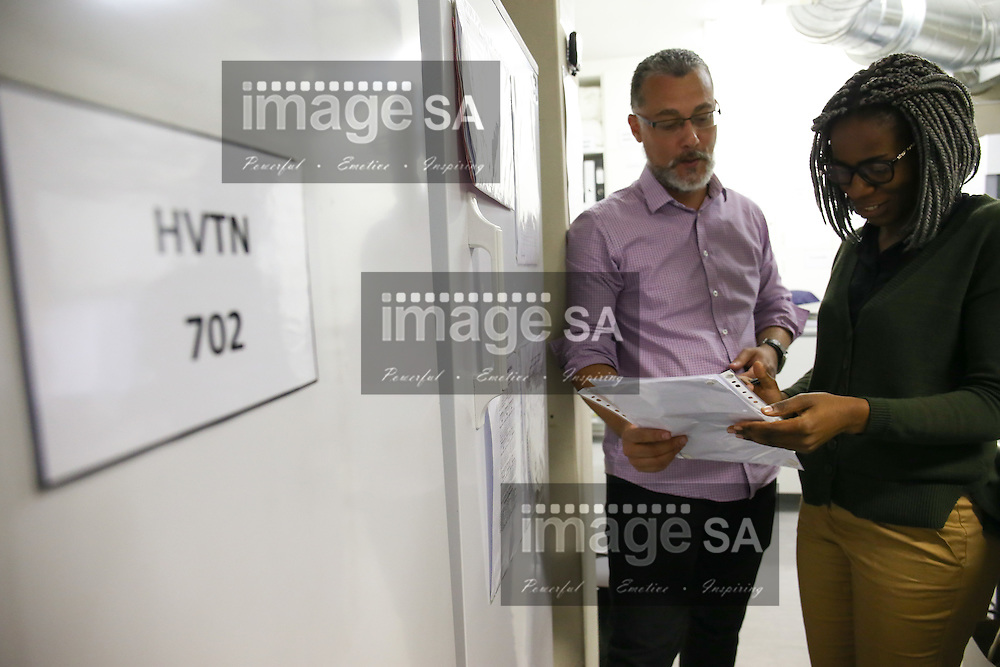 CAPE TOWN, SOUTH AFRICA - Wednesday 30 November 2016, Julio Muller and Mary Chianyika, the pharmacists, during the launch of a major study to test the efficacy of a vaccine to prevent HIV infection at the Emavundleni Research Centre in Old Crossroads, Cape Town. With more than 1 000 people in South Africa becoming infected with HIV each day, a successful HIV vaccine is seen as the key to ending the epidemic. This new preventive vaccine efficacy trial, called HVTN 702, is a critically important study and its start is a special moment in HIV research. HVTN 702 is the only current HIV vaccine efficacy trial in the world and is being conducted solely in South Africa. It has been seven years since the world last saw the start of an efficacy trial of an HIV vaccine. The South African study will test a modified form of the vaccine regimen used in RV144, a trial conducted in Thailand, which reported in 2009 that the candidate vaccine was 31.2% effective in preventing new HIV infections 3.5 years after first vaccination. HVTN 702 builds on the foundation of the promising Thai trial findings and seeks to increase the level of efficacy and durability of the vaccine response. If HVTN 702 is shown to be effective against new infections, this South African trial could lead to the licensing of the world&rsquo;s first HIV vaccine.<br /> Photo by Roger Sedres/ImageSA