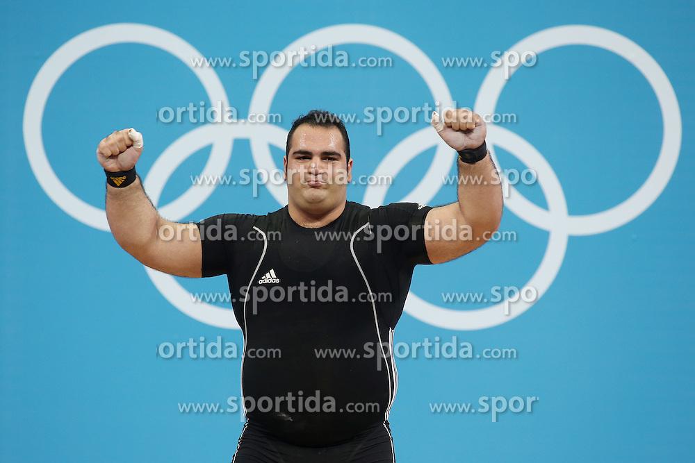 Olympic Games London 2012 - Olympische Spiele London 2012, Great Britain - Grossbritanien, weight lifting - Gewichtheben, men + 105kg - Maenner ueber 105kg, Gold medal winner Irans's Behdad Salimikordasiabi.© pixathlon