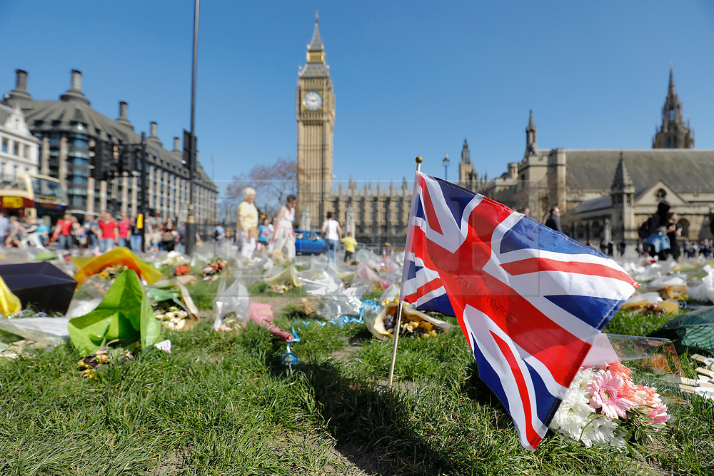 © Licensed to London News Pictures. 09/04/2017. London, UK.  Flowers left outside Carriage gate at The Houses of Parliament on the day that the coffin of PC Keith Palmer arrived at Chapel of St Mary Undercroft within the Palace of Westminster, ahead of his funeral tomorrow (Mon). PC Palmer was killed in a terror attack when Khalid Masood drove a car at pedestrians over Westminster Bridge and then attempted to enter Parliament with a knife. Photo credit: Tolga Akmen/LNP