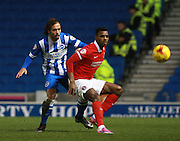 Charlton Athletic striker Ricardo Vaz Te shields the ball from Brighton defender full back Inigo Calderon during the Sky Bet Championship match between Brighton and Hove Albion and Charlton Athletic at the American Express Community Stadium, Brighton and Hove, England on 5 December 2015. Photo by Bennett Dean.