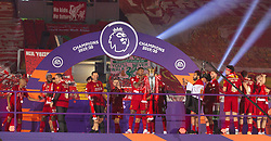 LIVERPOOL, ENGLAND - Wednesday, July 22, 2020: Liverpool's Georginio Wijnaldum lifts the Premier League trophy during the presentation as the Reds are crowned Champions after the FA Premier League match between Liverpool FC and Chelsea FC at Anfield. The game was played behind closed doors due to the UK government's social distancing laws during the Coronavirus COVID-19 Pandemic. (Pic by David Rawcliffe/Propaganda)