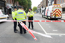 © Licensed to London News Pictures. 22/05/2018. London, UK. Police at the crime scene cordon in Upper Street, Islington which remains closed this morning. Police were called at approximately 18:30hrs on Monday, 21 May to reports of a man suffering stab injuries after being attacked in Upper Street.<br /> Officers and London Ambulance Service attended. The man was pronounced dead at the scene. Photo credit: Vickie Flores/LNP