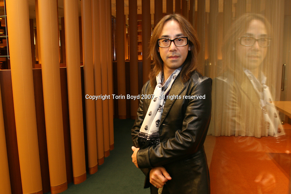 This is Japanese interior designer Yasumichi Morita at Resona BankÕs Tokyo Midtown branch which was designed by him and his company Glamourous Co., Ltd. This Osaka based artist has been gaining much attention designing restaurants, bars, and now banks in Japan, Hong Kong, New York, London and Shanghai. Resona Bank, Ltd. opened this branch in March 2007 in the new trendy building complex called Tokyo Midtown, located in the Roppongi district of central Tokyo. Photo taken Nov. 15, 2007.
