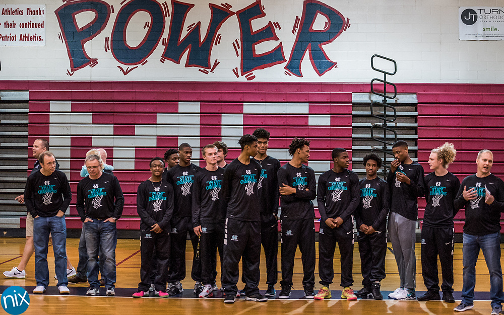 The Cox Mill basketball team celebrates the 3A Basketball State Championship during a rally at Harris Road Middle School Thursday afternoon.