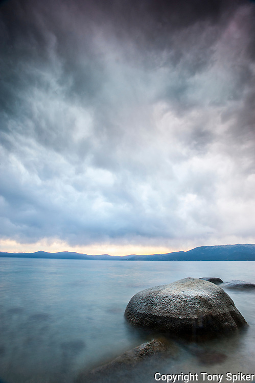 """Thunderbird Beach Sunset 5"" - A long exposure photograph of a clearing storm from Thunderbird Beach on the Eastern Shore of Lake Tahoe"