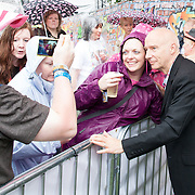Midge Ure poses for a photo with a fan. <br /> Images from Rewind Scotland 2014 which was held at Scone Palace Perth on 19th and 20th July.<br /> <br /> All images copyright Shaun Ward Photography