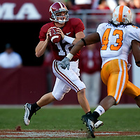 TUSCALOOSA, AL -- October, 24, 2009 -- University of Alabama quarterback Greg McElroy scrambles against a charging University of Tennessee linebacker Savion Frazier during the Crimson Tide's 12-10 victory over the Volunteers at Bryant-Denny Stadium in Tuscaloosa, Ala., Saturday, Oct. 24, 2009.