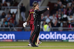 New Zealand's Lockie Ferguson celebrates taking the wicket of West Indies Sheldon Cottrell with Martin Guptill during the ICC Cricket World Cup group stage match at Old Trafford, Manchester.
