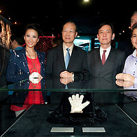 MACAU - FEBRUARY 01:  British singer Shaheen Jafargholi (R) and Hong Kong' singer Coco Lee (2nd L) pose for the media in front of the iconic white rhinestone glove worn by Michael Jackson at the 1983 Motown 25 Television Special during the opening ceremony of the MJ Gallery at Ponte 16 Resort-Macau on February 1, 2010 in Macau, China.  Photo by Victor Fraile / studioEAST