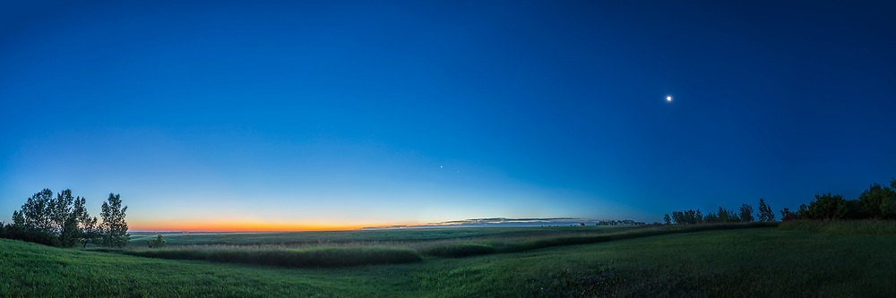A 120&deg; panorama of the dawn sky on July 16, 2017 with the northeast horizon (left) colourful with dawn twilight, Venus in the east (centre) near Aldebaran, and the waning Last Quarter Moon in the southeast (at right). This serves to demonstrate the 90&deg; angle between the waning quarter Moon and the sunrise point (and the Sun). And also the twiight colours on a very clear morning. The sky is also much darker toward the Moon at the 90&deg; point due to natural sky polarization. <br /> <br /> This is a 5-section panorama with the 14mm Rokinon lens and Canon 6D, stitched with PTGui. ACR would not stitch this.