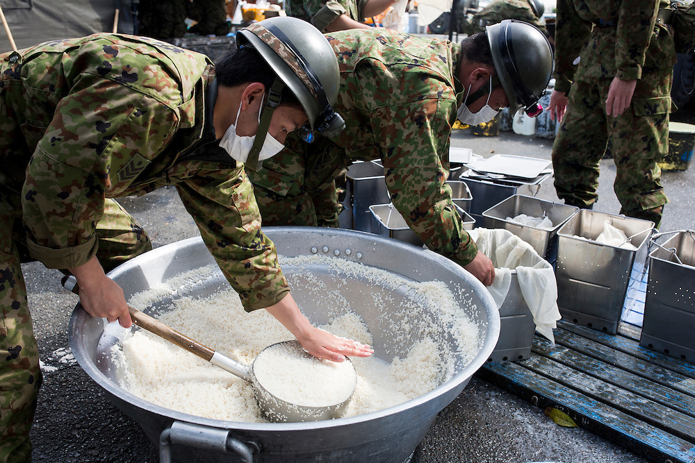 KUMAMOTO, JAPAN - APRIL 22:  Japan Self-Defense Forces (SDF) staffs make preparations to dispatch humanitarian aid food to the earthquake victims on April 22, 2016 in Mashiki town, Kumamoto, Japan. To date 48 people are confirmed dead and more than 80,000 people have evacuated after an 6.5 earthquake on Thursday night and a stronger 7.3 quake on Saturday morning struck the Kyushu Island in western Japan.<br /> <br /> Photo: Richard Atrero de Guzman