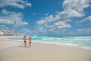 Walking on the beach in Cancun, Mexico.