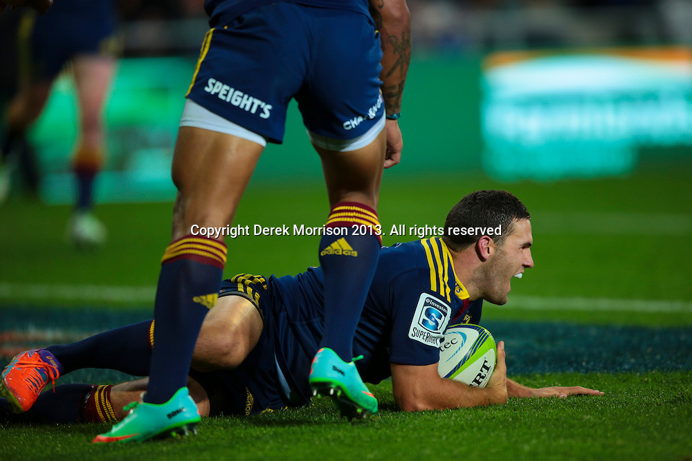 Highlanders inside centre Shaun Treeby scores a try off a grubber kick from Aaron Smith during the Round 5 Super Rugby match between Otago Highlanders and Western Force at Forsyth Barr Stadium, Dunedin. 15 March 2014. Photo: Derek Morrison/www.photosport.co.nz