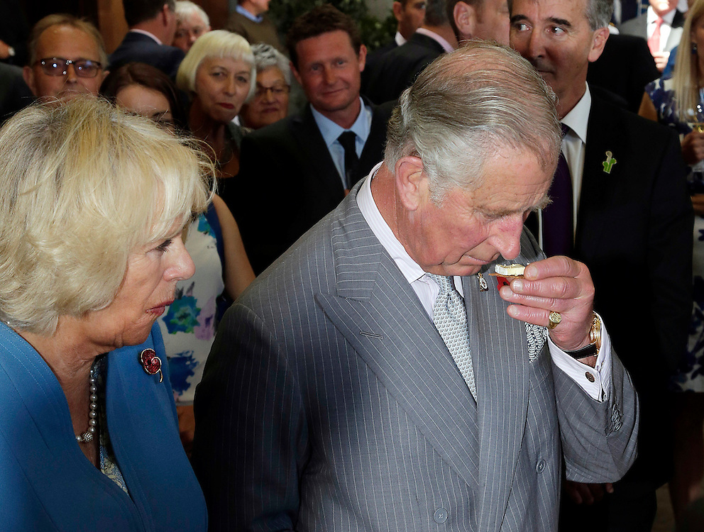 Prince Charles, Prince of Wales samples some cheese with Camilla, Duchess of Cornwall during their visit to Mahana winery near Nelson, New Zealand, Saturday, November 07, 2015. SNPA / Reuters, Anthony Phelps **POOL**