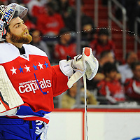 16 December 2015:  Washington Capitals goalie Braden Holtby (70) spits out a stream of water at the Verizon Center in Washington, D.C. where the Washington Capitals defeated the Ottawa Senators, 2-1.  (Photograph by Mark Goldman - Goldminephotos)