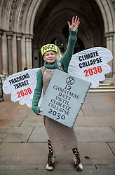 © Licensed to London News Pictures. 18/12/2018. London, UK. Vivienne Westwood and climate change activists dressed as an angel, Joseph and three wise men, outside the High Court to protest against fracking policy. Campaigners will challenge new planning guidance for fracking in the High Court today. Photo credit: Rob Pinney/LNP