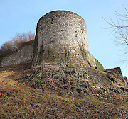 Ramparts with the Tour du Roi or King's tower, 13th century, at the medieval castle of Chateau-Thierry, Picardy, France. The first fortifications on this spur over the river Marne date from the 4th century and the first castle was built in the 9th century Merovingian period by the counts of Vermandois. Thibaud II enlarged the castle in the 12th century and built the Tour Thibaud, and Thibaud IV expanded it significantly in the 13th century to include 17 defensive towers in the walls and an East and South gate. The castle was largely destroyed in the French Revolution after having been a royal palace since 1285. In 1814 it was used as a citadel for Napoleonic troops. Picture by Manuel Cohen