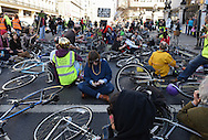 Cyclists block the road during the Time To Act, National Climate March organised by Campaign Against Climate Change in London, England on March 7, 2015