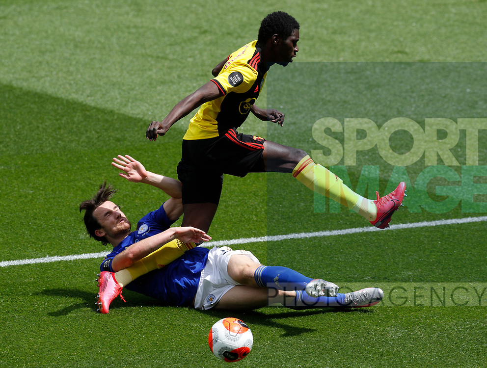 Ben Chillwell of Leicester City tackles Ismaila Sarr of Watford during the Premier League match at Vicarage Road, Watford. Picture date: 20th June 2020. Picture credit should read: Darren Staples/Sportimage