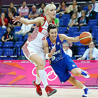 09 August 2012: France Celine Dumerc drives past Russia Natalya Vodopyanova during 81-64 Team France victory over Team Russia, during the women's basketball semi-finals, at the 02 Arena, in London, Great Britain.