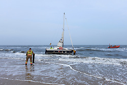 © Licensed to London News Pictures. 13/04/13 A yacht becomes stranded in on shore winds at Longsands beach Tynemouth during what many visitors declared the start of summer. The unknown private yacht was eventually rescued by the TVLB (Tynemouth Volunteer Life Brigade) and the RNLI to a cheering crowd of hundreds of walkers.  Photo credit : John Millard/LNP