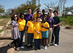 16 March 2008. New Orleans, Louisiana. Lower 9th ward.<br /> Movie stars Brad Pitt and Angelina Jolie pose with residents and former residents. They were in town with Former President Bill Clinton and 600 volunteers for the 'Make a Difference, Make a Commitment' clean up of the neighbourhood devastated by Hurricane Katrina. The massive clean up project was organised by Brad Pitt's Make it Right Foundation aided by the Clinton Global Initiative.<br /> Photo credit; Charlie Varley.