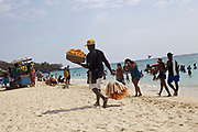 CARTAGENA, COLOMBIA - MAY 31, 2015: Beach vendor sells popcorn and snacks at Playa Blanca on the Isla Baru. The beach attracts vendors selling food, drinks, massage services and all manner of knick knacks. <br />