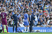 Brighton and Hove Albion manager Chris Hughton gives instructions to Brighton and Hove Albion midfielder Dale Stephens (6) during the Premier League match between Brighton and Hove Albion and Manchester City at the American Express Community Stadium, Brighton and Hove, England on 12 August 2017. Photo by Phil Duncan.