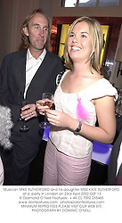 Musician MIKE RUTHERFORD and his daughter MISS KATE RUTHERFORD at a  party in London on 23rd April 2002.	OZF 13
