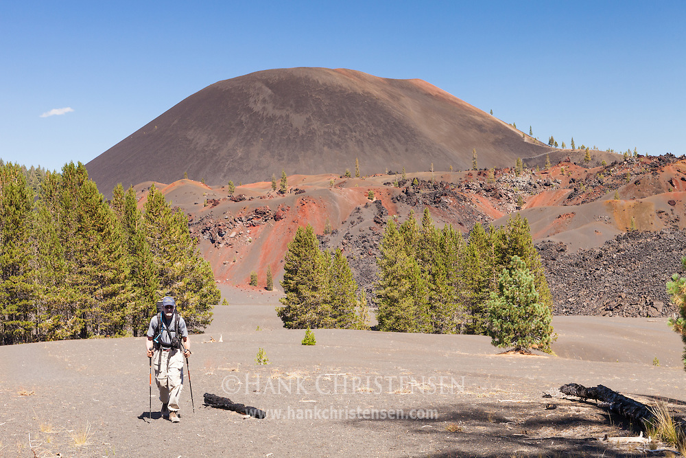 A backpacker heads west away from the Lassen Cinder Cone, Mt Lassen National Park.