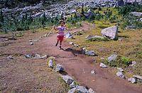Boy, 3, runs down the trail to Harmony Lake on Whistler Mountain. Whistler, BC Canada.