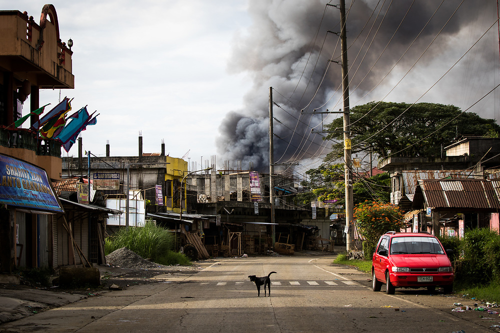 MARAWI, PHILIPPINES - JUNE 6: A smoke rages at houses following airstrikes by the Philippine Air Force in Marawi, Southern Philippines, June 6, 2017. Philippine military jets fired rockets at militant positions Tuesday as soldiers fought to control of the southern city from gunmen linked to Maute group an Islamist Rebel group. (Photo: Richard Atrero de Guzman/NUR Photo)
