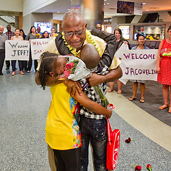 Dauda Balubwila, a refugee from Kenya and the Democratic Republic of Congo, shared a tearful reunion with his children Jeff Balubwila, right, 11 and Samantha Balubwila, left, 8 at the Boise Airport. The two children, along with sister Jacqueline Waithera and Dauda's wife Elizabeth NG'ANG'A (both off camera) were reunited on Tuesday night after five years of separation. Balubwila works as a case worker at the International Rescue Commission, one of three refugee resettlement agencies in Boise. Tuesday August 2, 2016