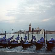 Gondolas line the canal ways of Venice near Piazza San Marco. Venice, Italy. 1st May 2011. Photo Tim Clayton