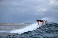 Patagonia ambassador Liz Clark getting some morning waves. French Polynesia