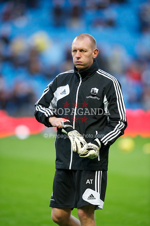 MANCHESTER, ENGLAND - Saturday, October 27, 2012: Swansea City's goalkeeping coach Adrian Tucker warms-up before the Premiership match against Manchester City at the City of Manchester Stadium. (Pic by David Rawcliffe/Propaganda)