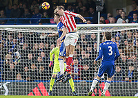 Football - 2016 / 2017 Premier League - Chelsea vs. Stoke City <br /> <br />  Peter Crouch of Stoke City beats Gary Cahill of Chelsea to head across goal and set up the Stoke equaliser at Stamford Bridge.<br /> <br /> COLORSPORT/DANIEL BEARHAM