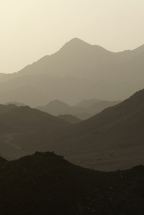 Oman, Mayser. February/01/2008...The graduated landscape of the Western Hajar Mountains at dusk.
