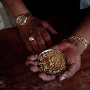 Brasile, Amazzonia, garimpo de Juma. Le miniere a cielo aperto del garimpo de Juma, dove la vita dei minatori scorre tra pericolo per un lavoro al limite e deforestazione incontrollata. Aspettando di trovare l'oro che cambi la loro vita. In questa foto uno dei compratori d'oro che esercitano all'interno del villaggio minerario. Brazil, Amazonia, garimpo de Juma. The open pit mines of garimpo de Juma, where the miners work flows between danger and uncontrolled deforestation. Waiting to find the gold that changes their lives. In this picture one of the buyers of gold mining village in the exercise.
