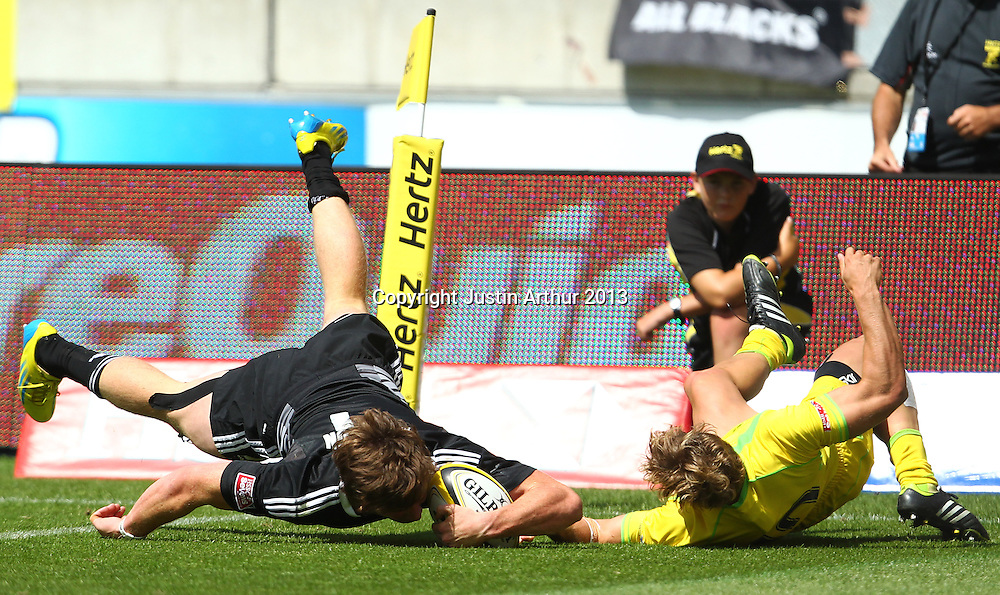 New Zealand's Sam Dickson scores as Australia's Lewis Holland fails to make the tackle. Hertz Wellington Sevens - Day Two at Westpac Stadium, Wellington, New Zealand on Saturday 2 February 2013. Photo: Justin Arthur / photosport.co.nz