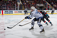 KELOWNA, CANADA - OCTOBER 4:  on October 4, 2017 at Prospera Place in Kelowna, BritishScott Walford #7 of the Victoria Royals passes the puck away from Wil Kushniryk #14 of the Kelowna Rockets Columbia, Canada.  (Photo by Marissa Baecker/Shoot the Breeze)  *** Local Caption ***