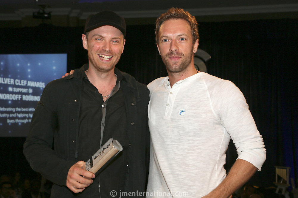 (L-R)  Jonny Buckland (Coldplay) and Chris Martin (Coldplay). The Silver Clef Lunch 2013 in aid of  Nordoff Robbins held at the London Hilton, Park Lane, London.<br /> Friday, June 28, 2013 (Photo/John Marshall JME)