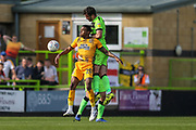 Forest Green Rovers Gavin Gunning(16) out jumps Cambridge United's Jevani Brown(20) during the EFL Sky Bet League 2 match between Forest Green Rovers and Cambridge United at the New Lawn, Forest Green, United Kingdom on 22 April 2019.
