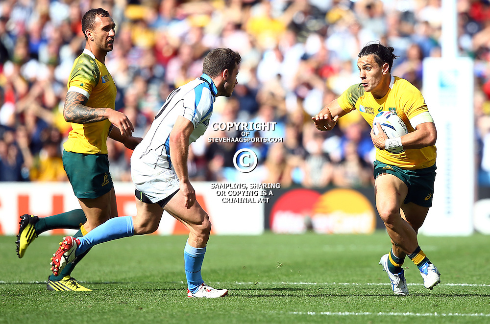 BIRMINGHAM, ENGLAND - SEPTEMBER 27: Matt Toomua of Australia looks to hand off Felipe Berchesi of Uruguay during the Rugby World Cup 2015 Pool A match between Australia and Uruguay at Villa Park on September 27, 2015 in Birmingham, England. (Photo by Steve Haag/Gallo Images)