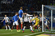 Portsmouth Defender, Matt Clarke (5) with a header at goal during the EFL Sky Bet League 1 match between Portsmouth and Charlton Athletic at Fratton Park, Portsmouth, England on 11 December 2018.