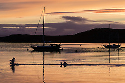 The sun rises over Small Isles Bay at Craighouse in Jura, Southern Hebrides