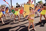 "03 JANUARY 2009 -- PHOENIX, AZ: Callie Combs, (CQ), 3,  from Desert West Dance Academy in Buckeye performs the 60's classic ""Itsy Bitsy Teensy Weensie Yellow Polka Dot Bikini"" in the annual Ft. McDowell Fiesta Bowl parade through Phoenix, AZ. More than 150,000 spectators line the parade routes which starts in north Phoenix and winds down Central Ave and 7th Street before ending in central Phoenix. More than 100 units march in the parade.  PHOTO BY JACK KURTZ"